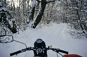 Motorcycles with sidecars in winter forest