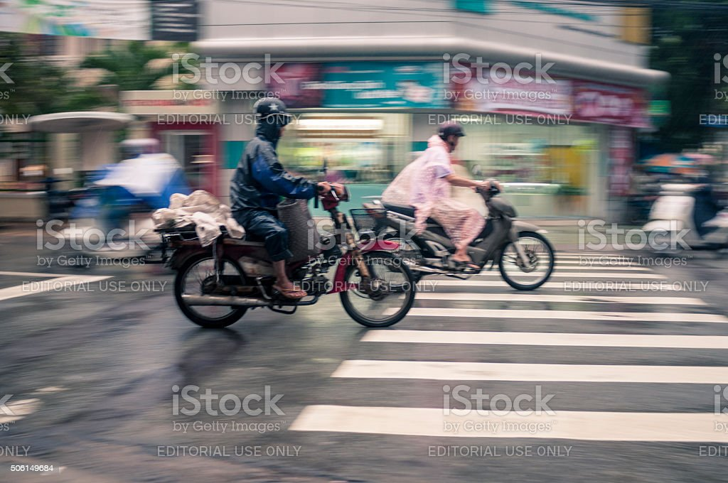 Motorcycling Through A Storm In Vietnam stock photo