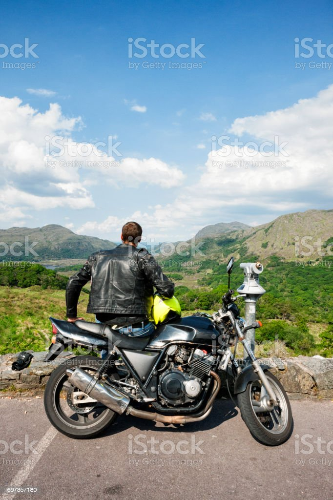 Motorcyclist at Ladies View on the Ring of Kerry, Ireland stock photo