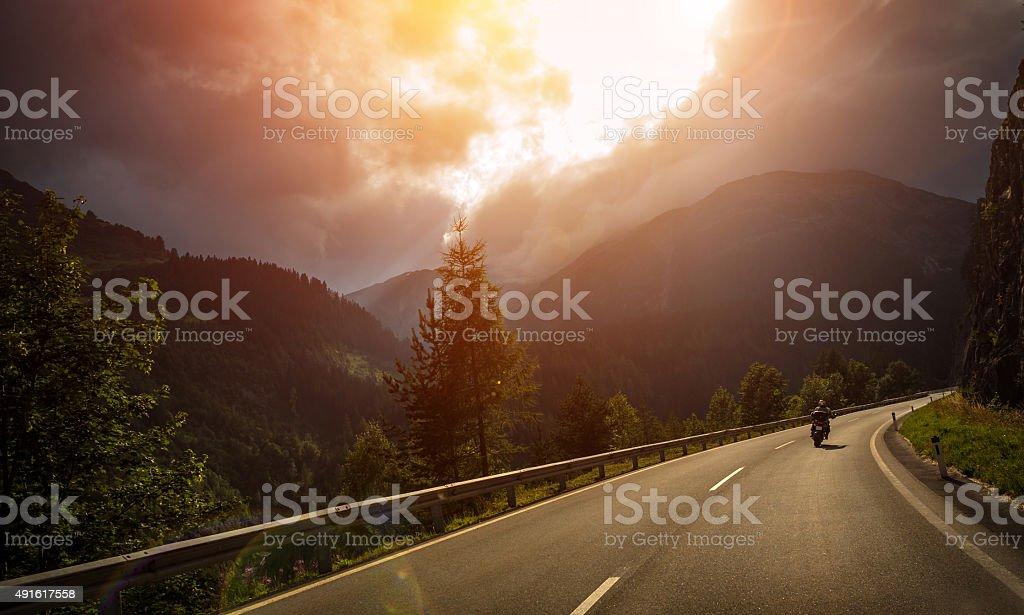 Motorcyclist in action in sunset light stock photo