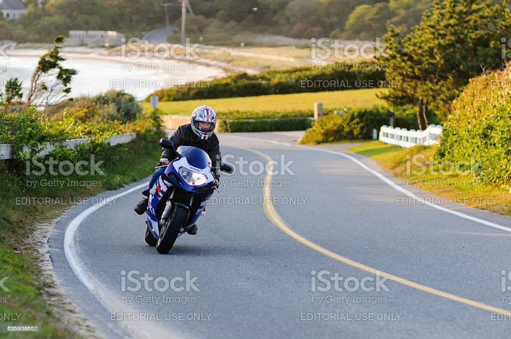 Motorcyclist leaning into curve stock photo