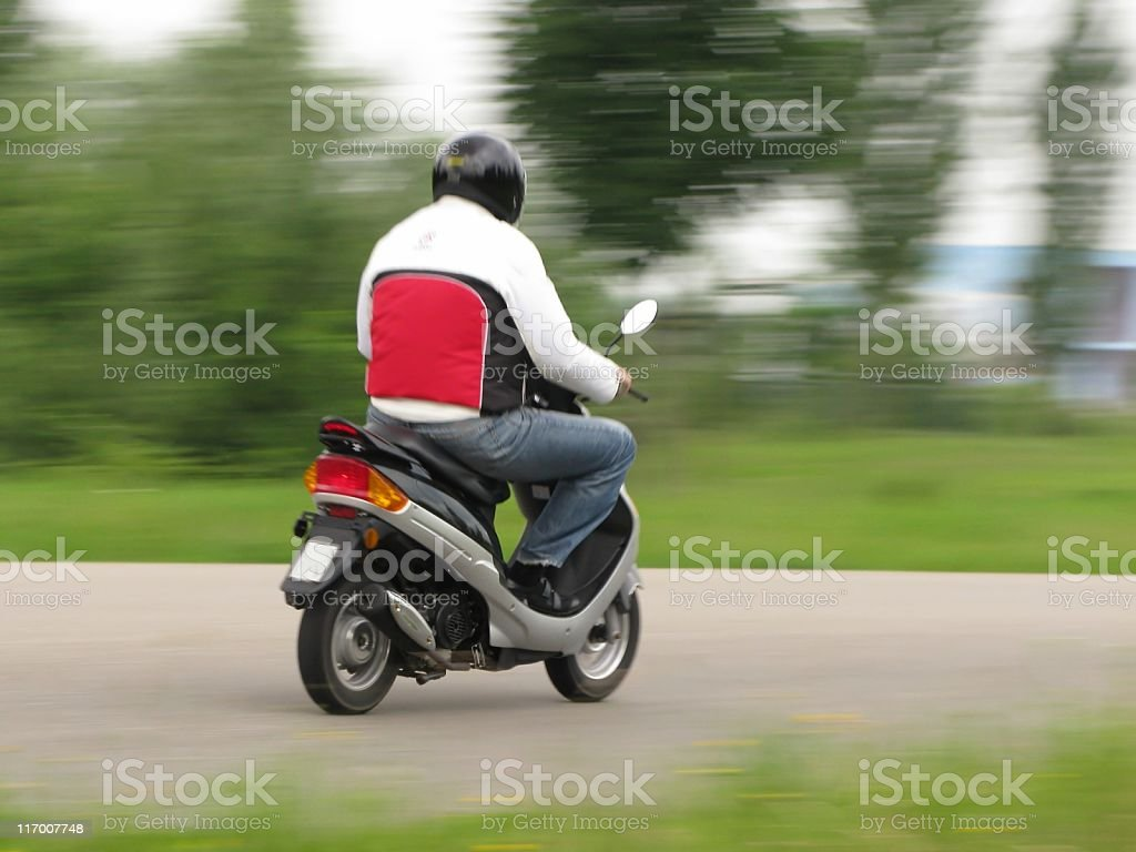 Motorcyclist on the road stock photo