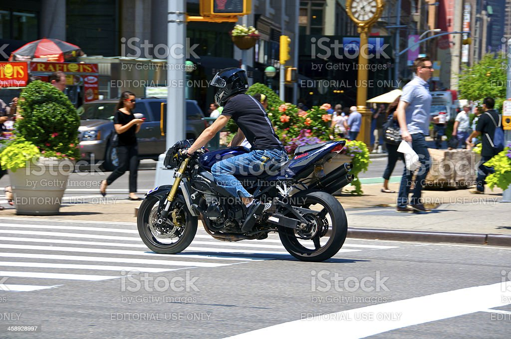 'Motorcyclist & pedestrians at E.23rd St, 5th Ave., Manhattan, NY' stock photo