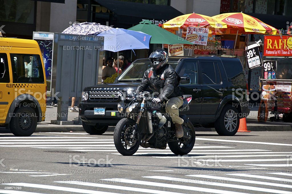 'Motorcyclist, SUV & Taxi at E.23rd St, Manhattan, NYC' stock photo