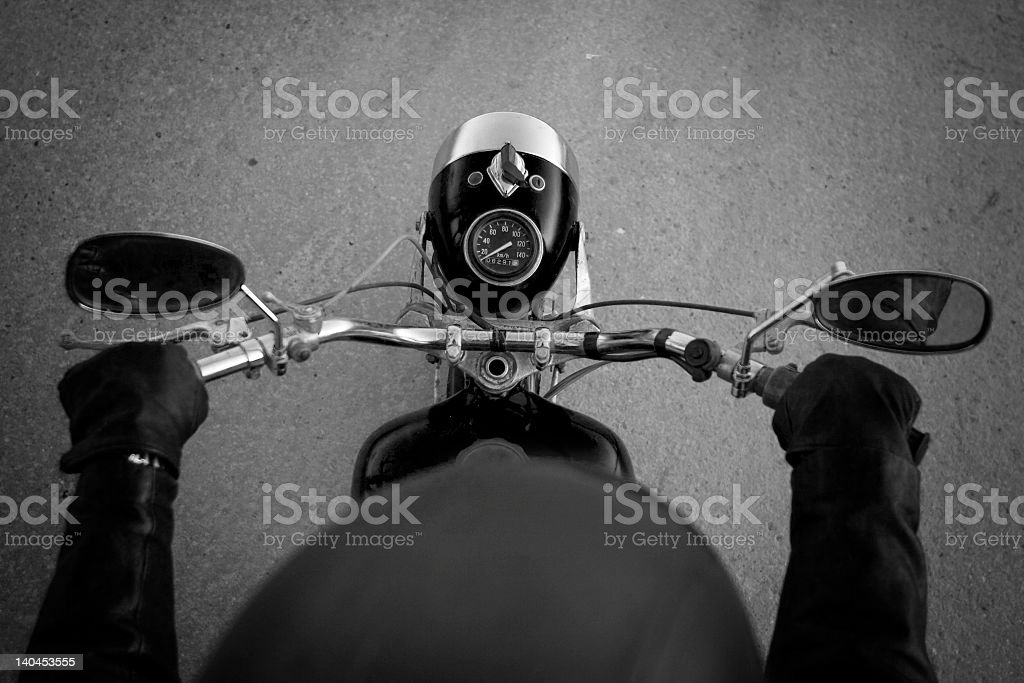 A motorcyclist with a helmet camera royalty-free stock photo