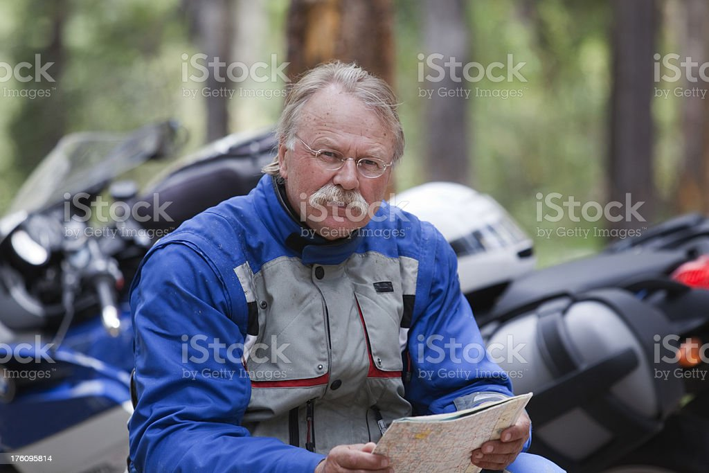 Motorcyclist with map royalty-free stock photo