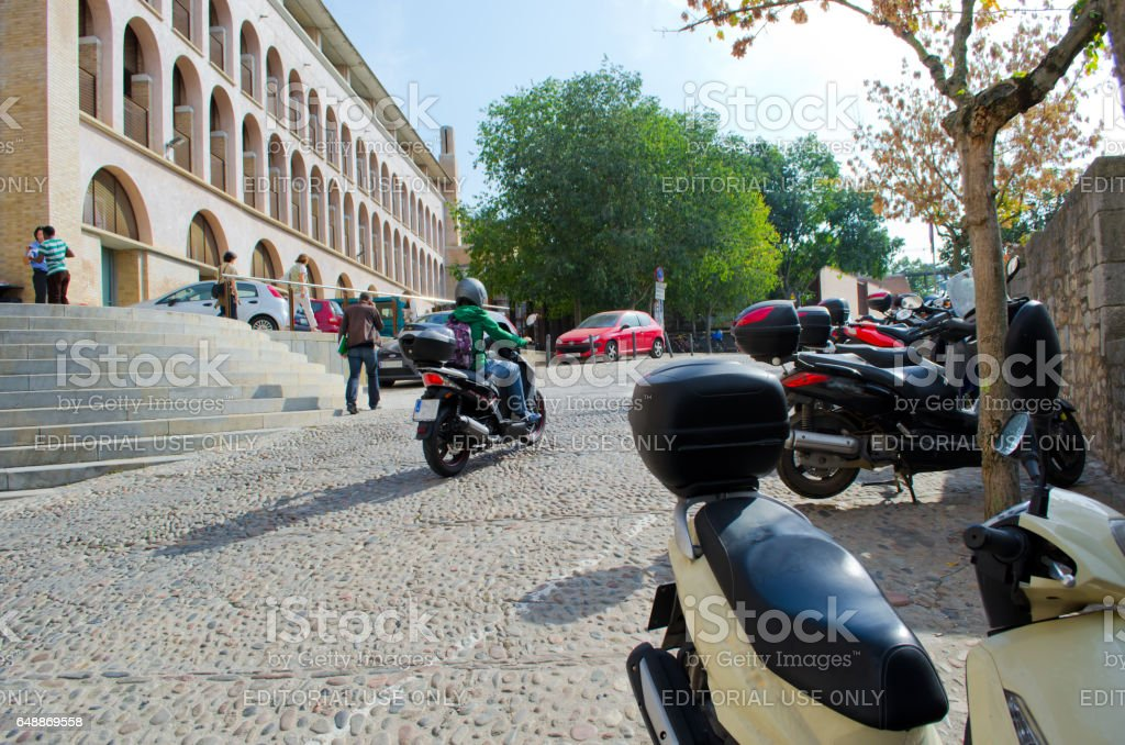 GIRONA - OCTOBER 21: Motorcyclists and unknown people on city streets. Girona on October 21, 2013, Spain. stock photo