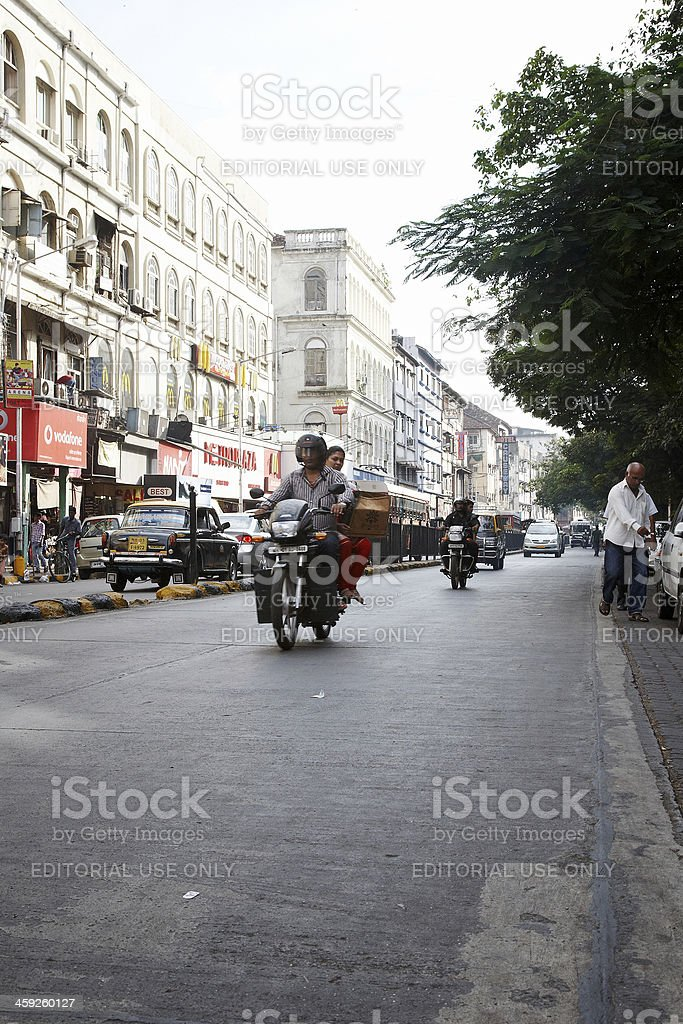 Motorcyclists carrying their wives on Mumbai street stock photo