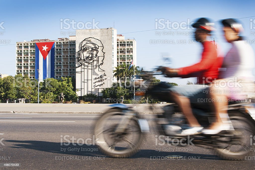 Motorcyclists Passing Che Guevara Image, Ministry of Interior Building, Havana stock photo