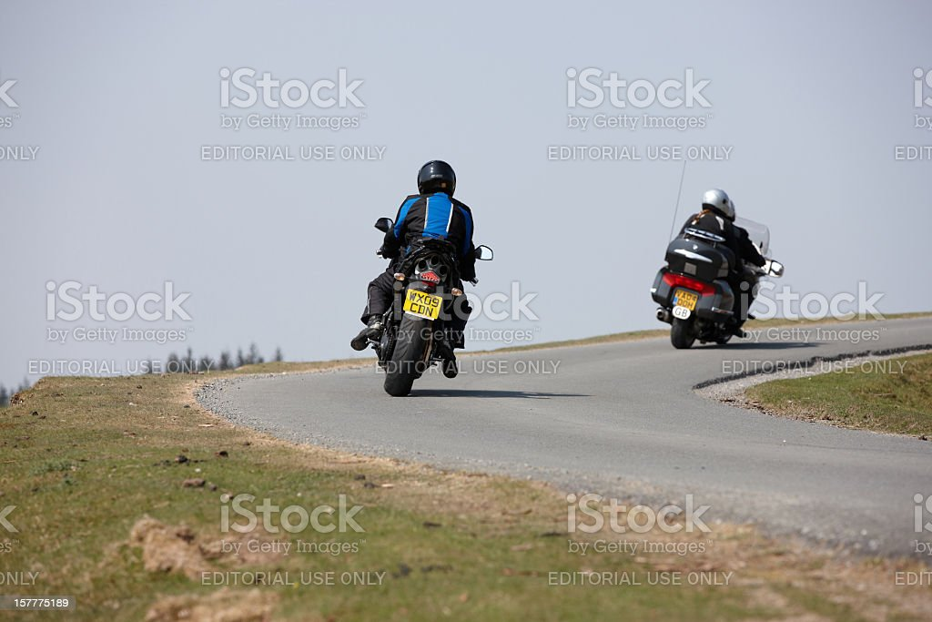 Motorcyclists taking a bend on remote Welsh mountain road stock photo