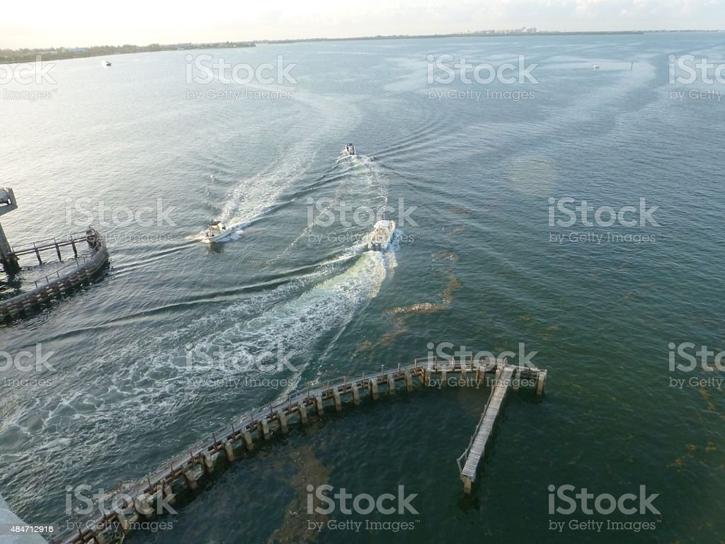 3 motored boats stock photo