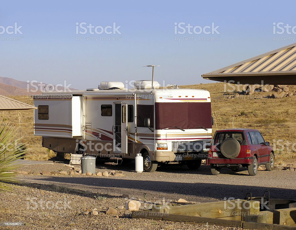 Motorhome and SUV in Campground stock photo