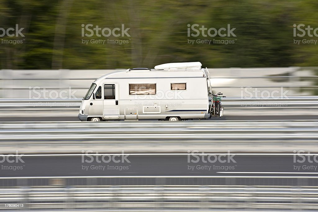 Wohnmobil car on highway royalty-free stock photo