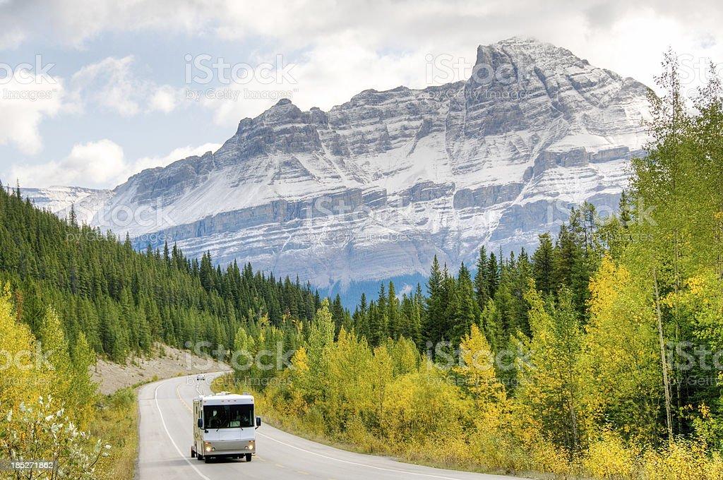 Motorhome drives through mountains royalty-free stock photo