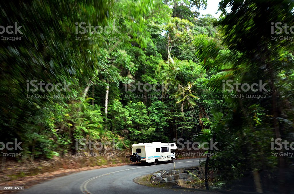 Motorhome driving drive through Daintree National Park in the...