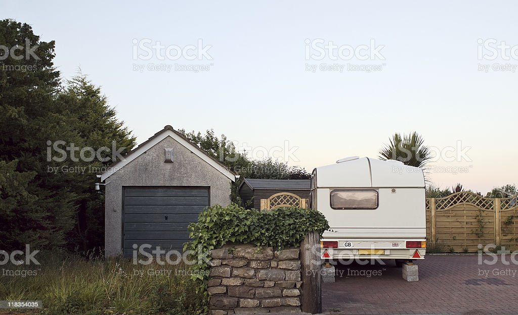 Motorhome parked near a shed stock photo