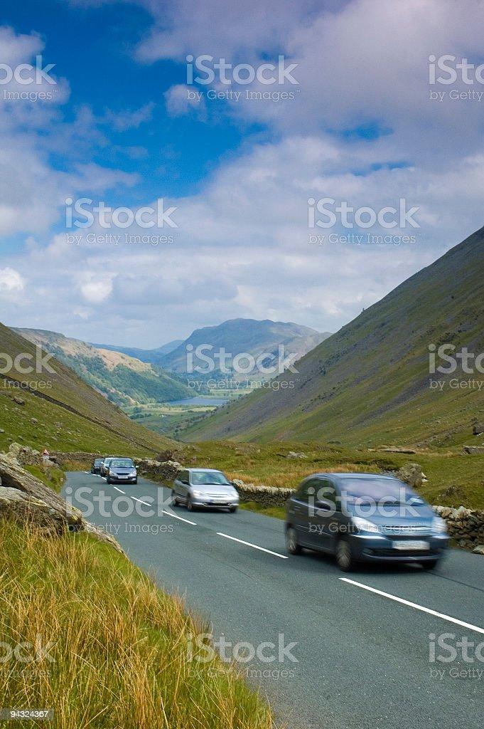 Motoring over mountain pass stock photo