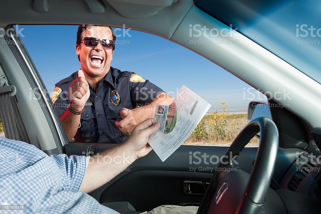 Motorist Bribing Traffic Police Officer stock photo