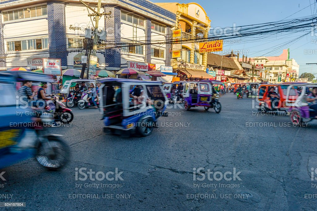 Motorized tricycle traffic. stock photo