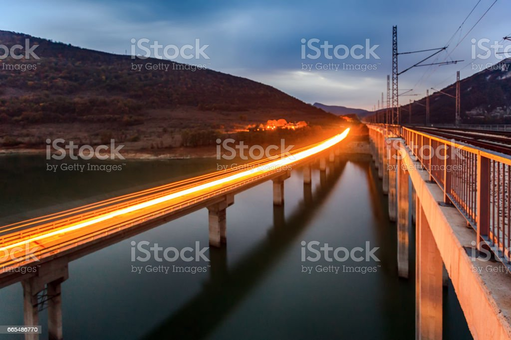 Motorway and railroad side by side stock photo