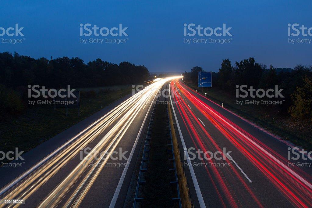 motorway at night stock photo