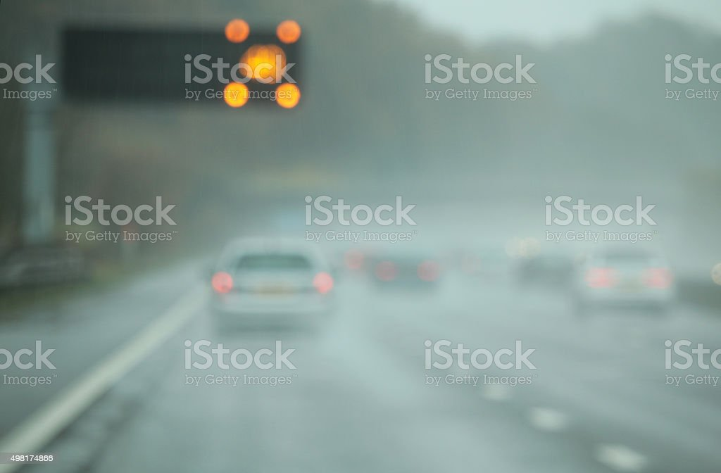 The M6 motorway in England on a wet November day, with speed warning...