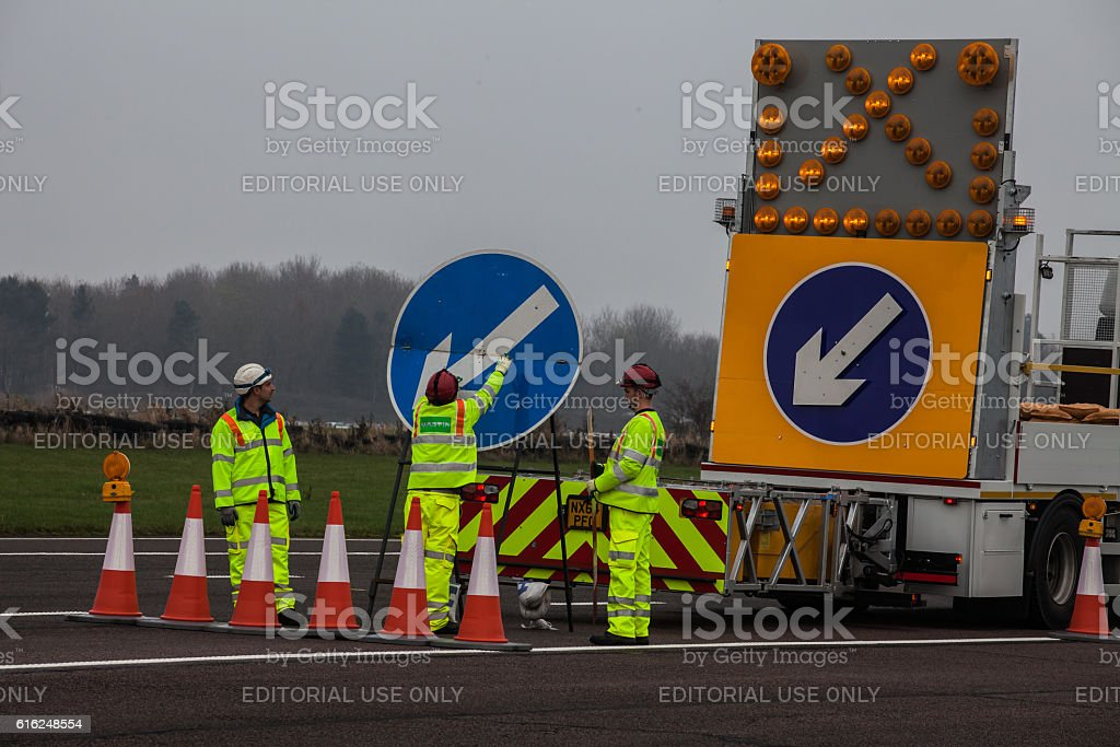 Motorway Sign being erecting stock photo