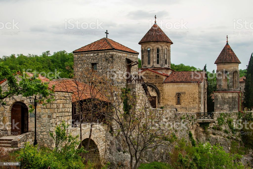 Motsameta Monastery - a small temple in the surrounding area of Kutaisi. It buried Martyrs David and Constantine. It located in a picturesque location on a cliff at the winding river. stock photo