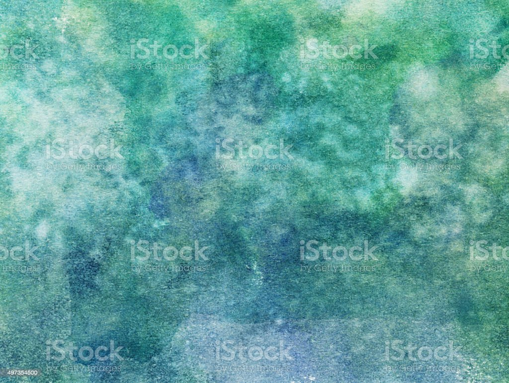 Mottled green texture with hues of blue and green stock photo