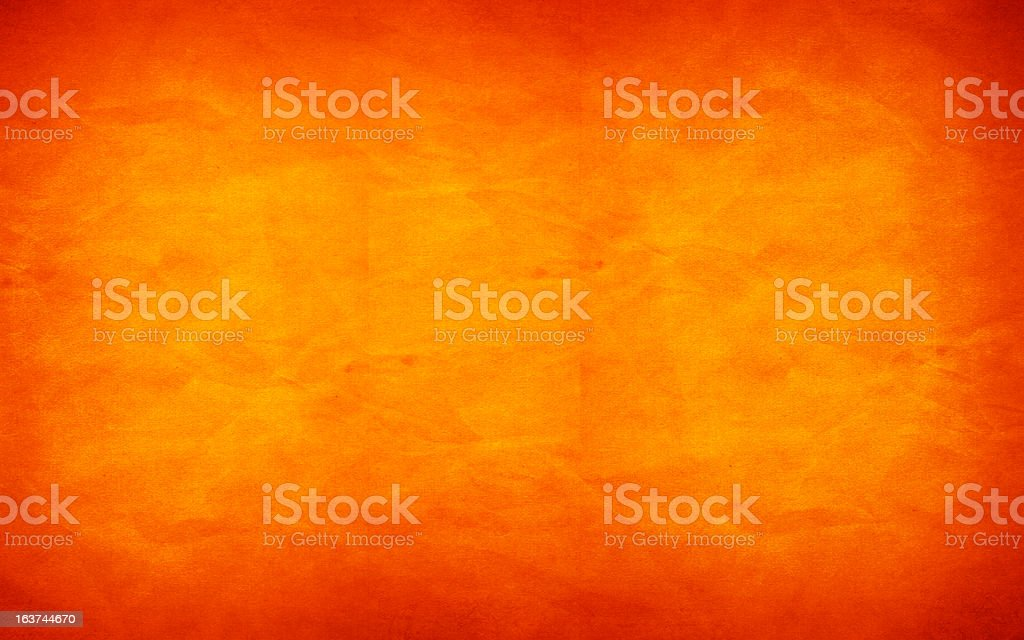 Mottled orange background with fading in middle stock photo