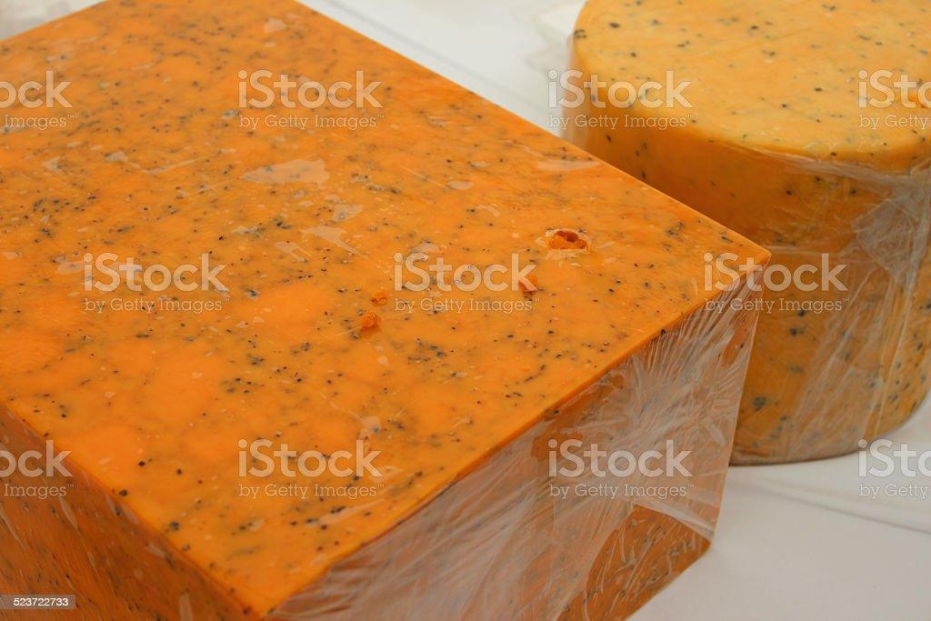 Mottled orange cow's milk blue-cheese blocks, Shropshire blue cheeses, orange-colour stock photo