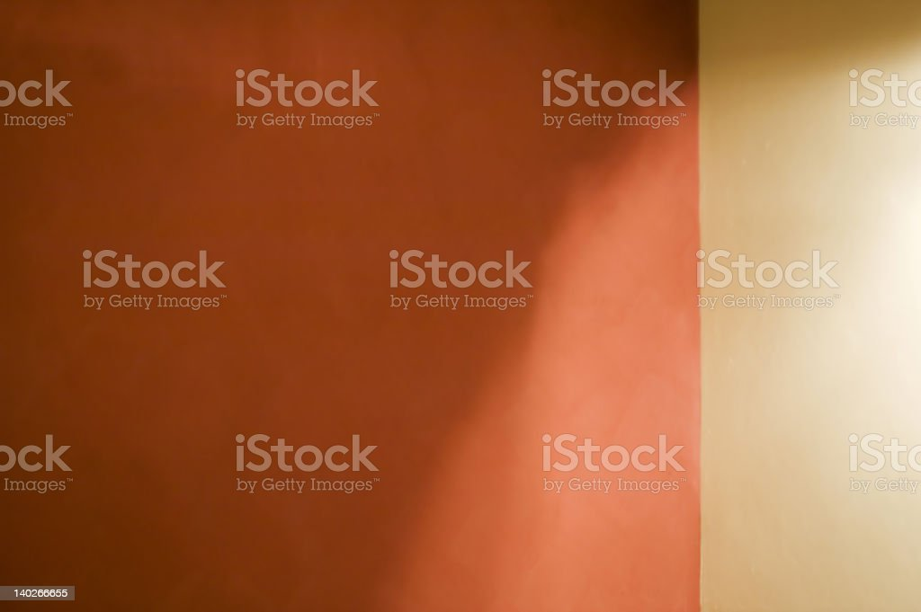 Mottled Wall with lights and shadows stock photo