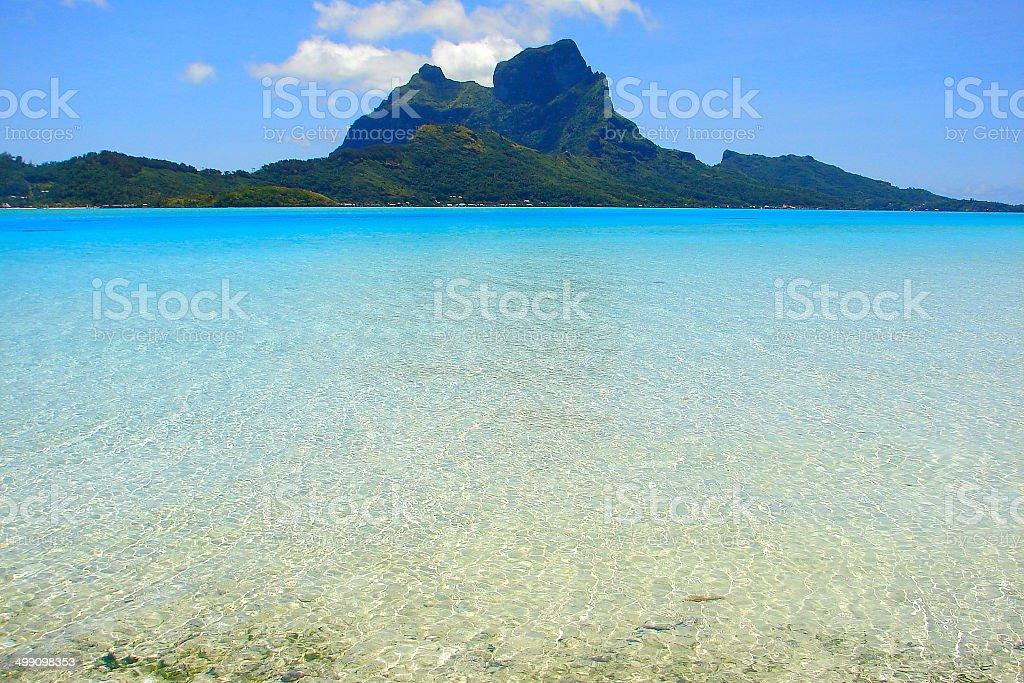 Motu view of Bora Bora Volcanic Island and turquoise waters , Polynesia royalty-free stock photo