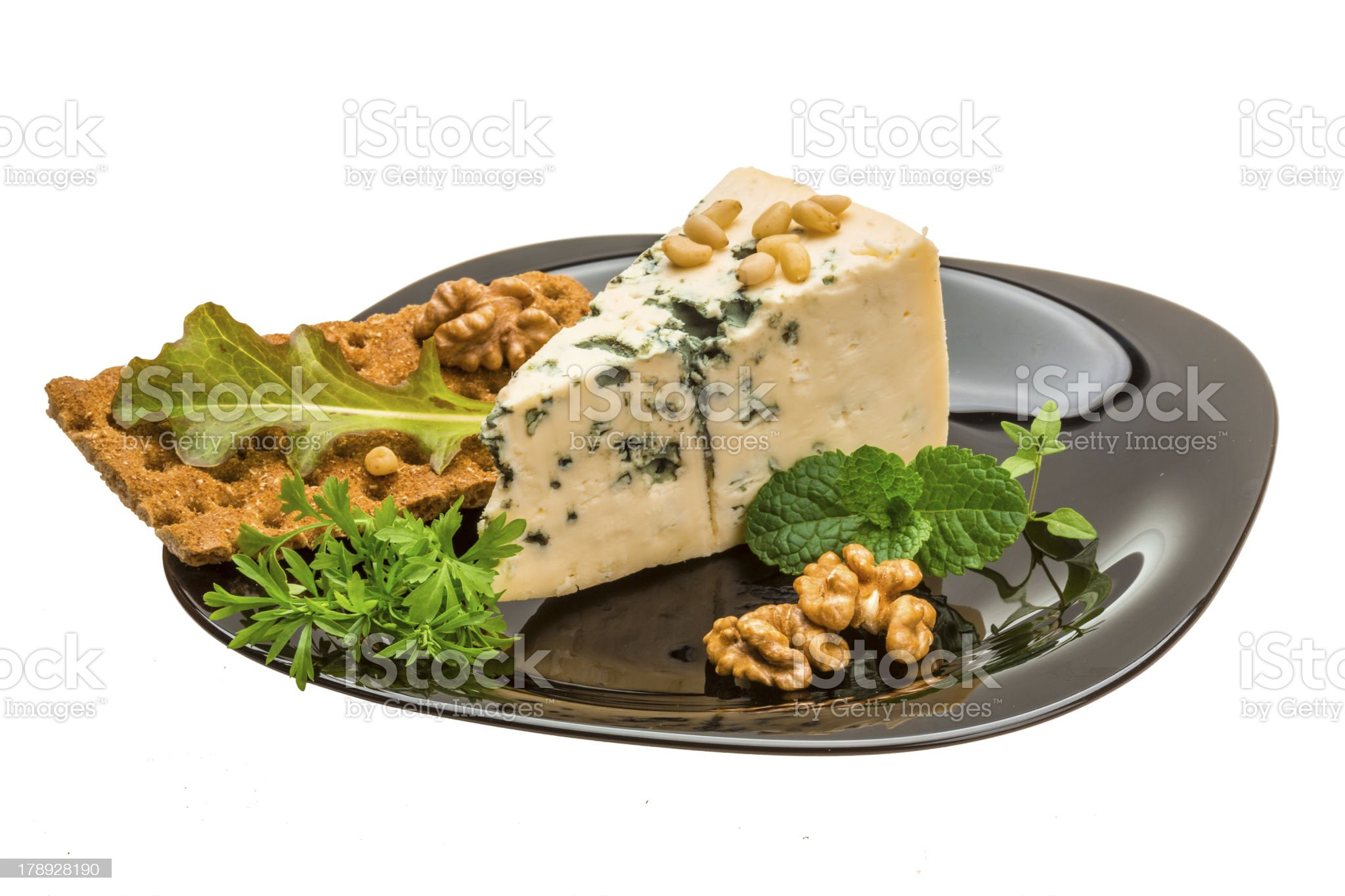 Mould cheese with salad, nuts and crisp royalty-free stock photo