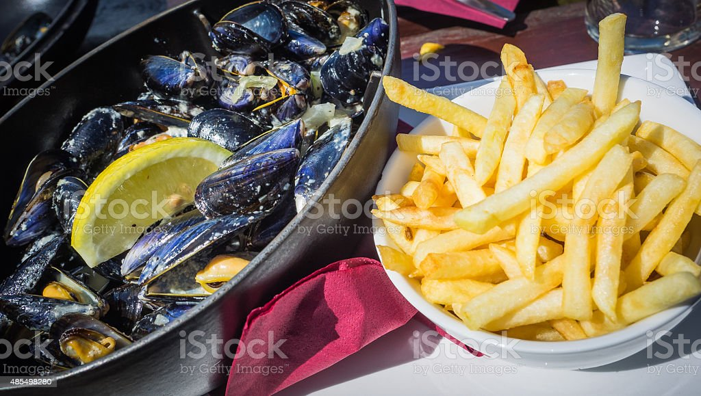 Moules mariniere and fries stock photo