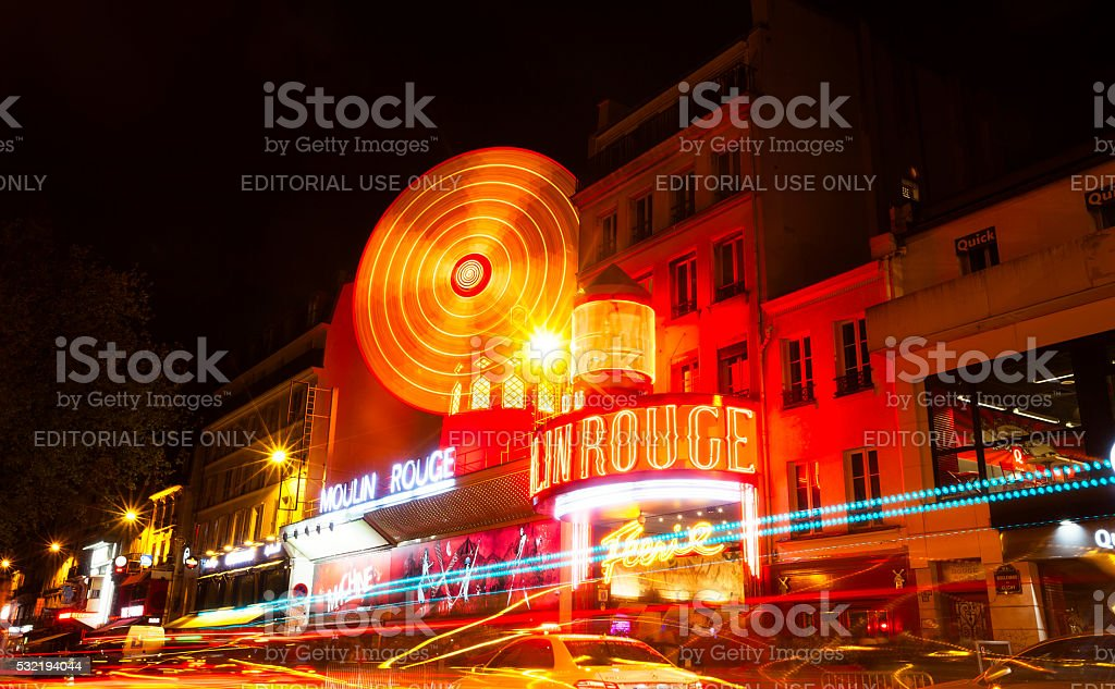 Moulin Rouge illuminsted at night, Paris stock photo