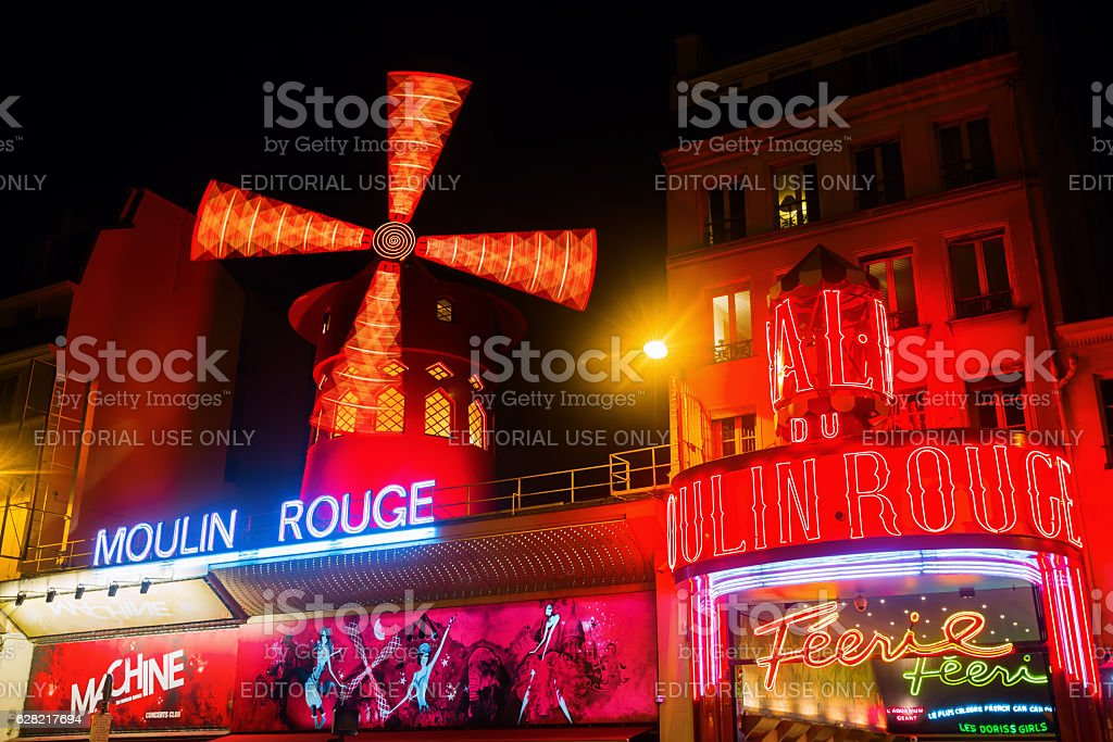 Moulin Rouge in Paris, France, at night stock photo