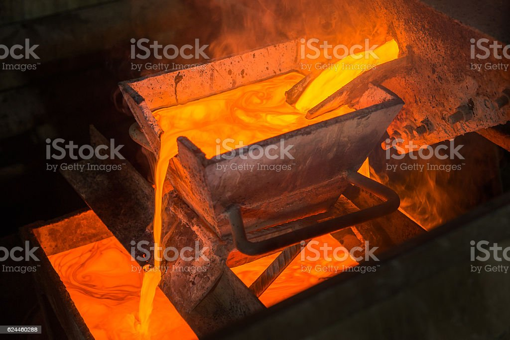 Moulting gold at a factory stock photo