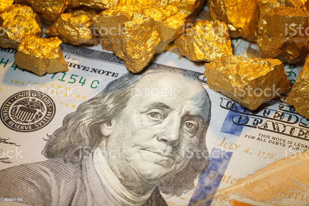 mound  gold and dollar bill stock photo