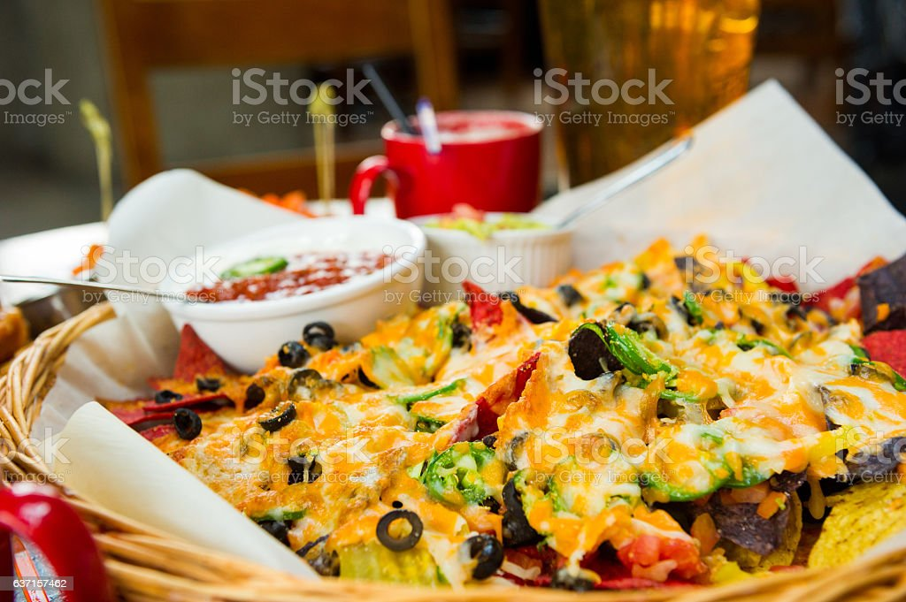 Mound of cheesy nachos stock photo