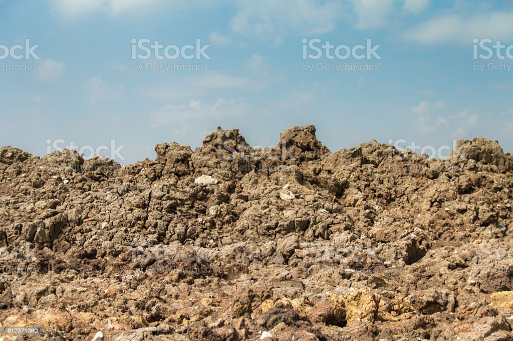 mound of earth with blue sky stock photo