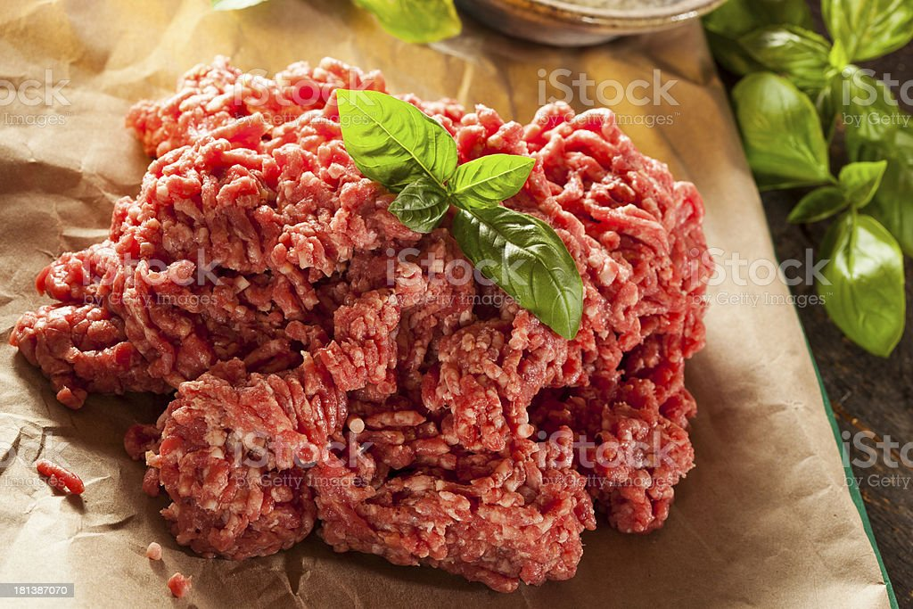 Mound of minced meat topped with sprig of basil stock photo
