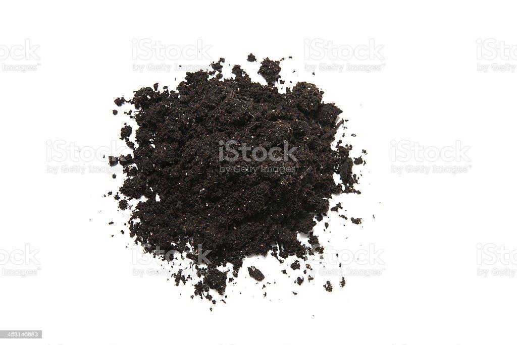 Mound of potting soil isolated on white background stock photo