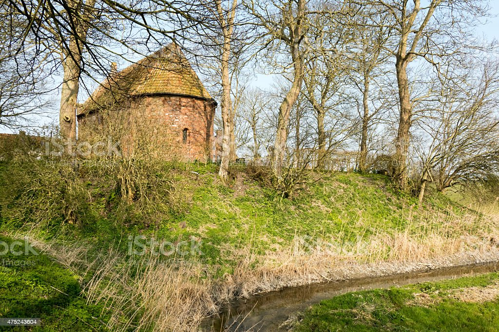 Mound with a church. stock photo
