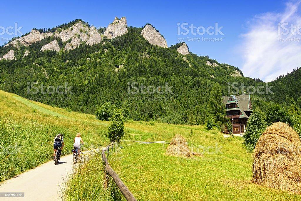 Mounntain landscape and tourists stock photo