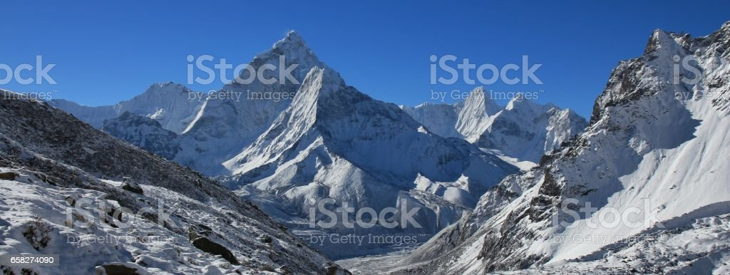 Mount Ama Dablam and other snow covered mountains stock photo