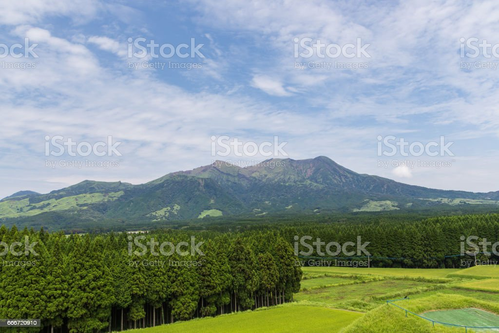 Mount Aso volcano and green field in Kumamoto, Japan stock photo
