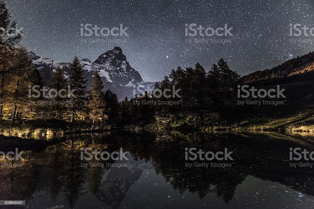 Mount Cervino and Blue Lake in an autumn night stock photo