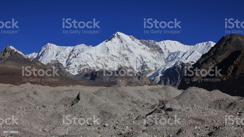 Mount Cho Oyu and moraine of the Ngozumpa glacier stock photo