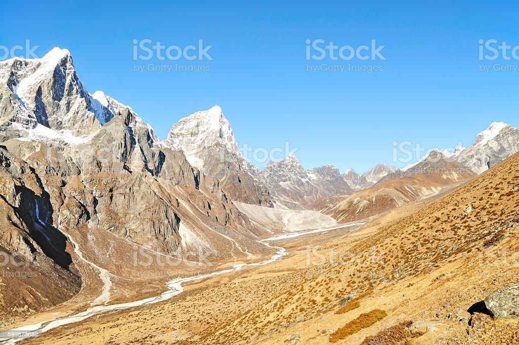 Mount Cholatse Overlooking Beautiful Valley, Everest Base Camp Trek, Nepal stock photo